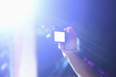 Photographing with digital camera at the concert Stock Images