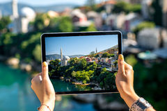 Photographing with digital tablet Mostar city Royalty Free Stock Photography