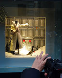 Photographing Fifth Avenue Christmas window. Taking pictures of a Fifth Avenue shop window festively decorated for the Christmas season. The store front windows stock photos