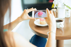 Photographing food in a coffee shop Stock Image