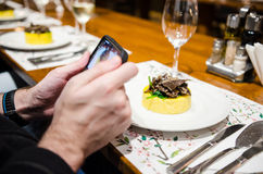 Photographing food at restaurant Royalty Free Stock Photo