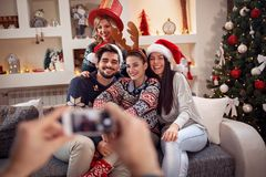 Photographing friends by phone for Christmas. Eve Royalty Free Stock Photos