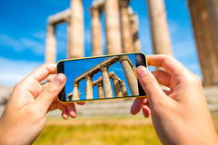 Photographing Greek temple ruins with mobile phone Royalty Free Stock Image