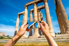 Photographing Greek temple ruins with mobile phone Stock Photos