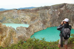 Photographing the Kelimutu Crater Lakes royalty free stock photography