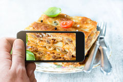 Photographing lasagna Royalty Free Stock Photo