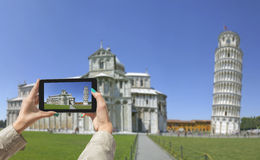 Photographing Leaning Tower in Pisa, with tablet Royalty Free Stock Image