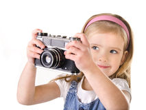 Photographing little girl with old camera isolated Royalty Free Stock Images