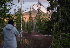 Photographing Mt Washington. A photographer catching the sunset on Mt Washington in Oregon Stock Photography