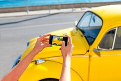 Photographing old yellow car Royalty Free Stock Image