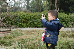 Boy photographing Royalty Free Stock Photography