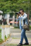 Photographing in park Stock Photo