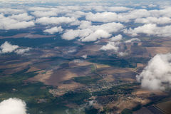 Photographing from a plane window. Flying a plane over the clouds Royalty Free Stock Image