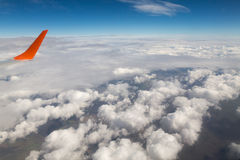 Photographing from a plane window. Flying a plane over the clouds Royalty Free Stock Photo