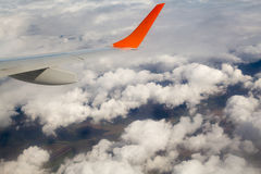 Photographing from a plane window. Flying a plane over the clouds Royalty Free Stock Photos