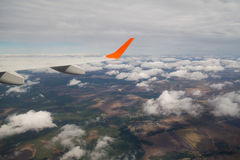 Photographing from a plane window. Flying a plane over the clouds Stock Images