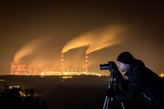 Photographing power plant at night. Royalty Free Stock Images