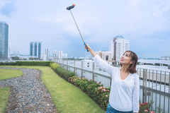 Photographing with selfie stick Royalty Free Stock Photos