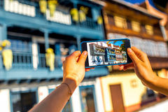 Photographing with smart phone old colorful balconies Stock Photography