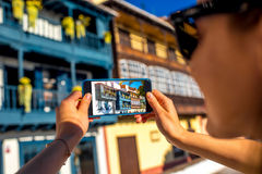 Photographing with smart phone old colorful balconies Royalty Free Stock Photo
