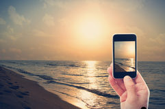 Photographing smartphone dawn Stock Images