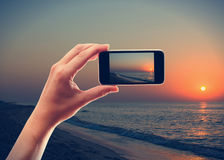 Photographing the sunrise Stock Photography
