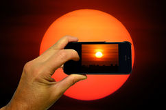 Photographing a sunset Royalty Free Stock Images