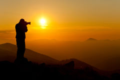 Photographing sunset in the mountains Stock Photo