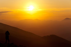 Photographing sunset in mountains Stock Image