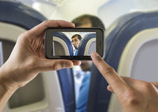 Photographing a surprised man on a plane Royalty Free Stock Photography