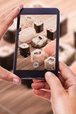 Photographing sushi rolls Royalty Free Stock Images
