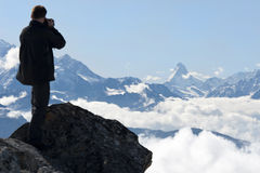 Photographing Swiss Alps Royalty Free Stock Images