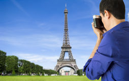Photographing tower eiffel. Man photographing with camera old tower eiffel in paris Royalty Free Stock Photos