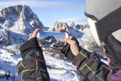 Photographing winter landscape with smart phone Royalty Free Stock Image