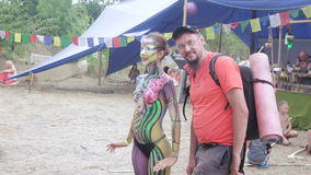 Photographing Woman body painting. ODESSA, UKRAINE - JULY 2016: Ethno esoteric festival Fabulous city. Training Alpha Gravity. July 2016 in Odessa, Ukraine stock video