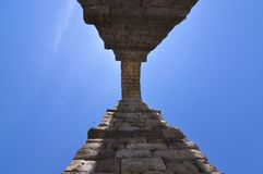 Photographs From The Base Of One Of The Arches Of The Aqueduct To Be Able To Intuit Its Greatness In Segovia. Architecture, Travel. History. June 18, 2018 Stock Photo