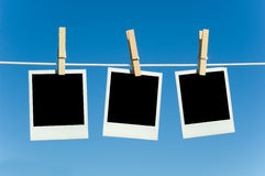 Photographs on a clotheline Stock Photography