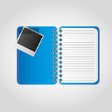 Photographs notebook. Photographs with notes on the notebook Stock Images