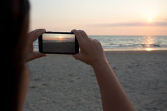 Photographs by phone. At sunset stock photo