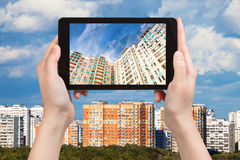 Photographs picture of apartment houses on tablet Stock Photos