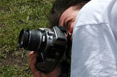 Photography. Photographer getting the right angles Royalty Free Stock Image