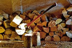 Wood chopping. Photography of an axe and chopping woods royalty free stock photos