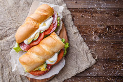 Photography of baguette at table Royalty Free Stock Photos