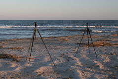 Photography on beach. Two tripods on the beach. preparations for photography during sunset Stock Image