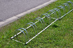 Photography of bicycle metal stand on the grass Stock Image