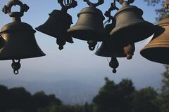 Photography of Black Hanging Bells during Daytime Stock Images
