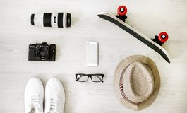 Photography of Black Skateboard, White Iphone 5, Brown Hat, Black Point-and-shoot Camera, and Zoom Lens royalty free stock images