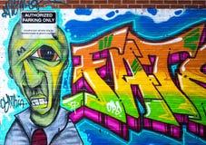 Photography of Brick Wall With Graffiti Stock Photo