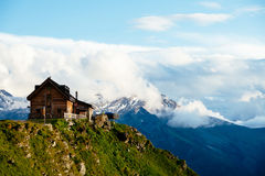 Photography of Brown Wooden House Top of Mountain Under White Sky during Daytime Stock Photos