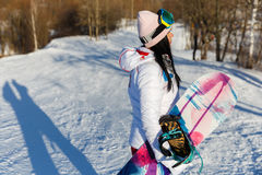 Photography of brunette with snowboard Royalty Free Stock Photos